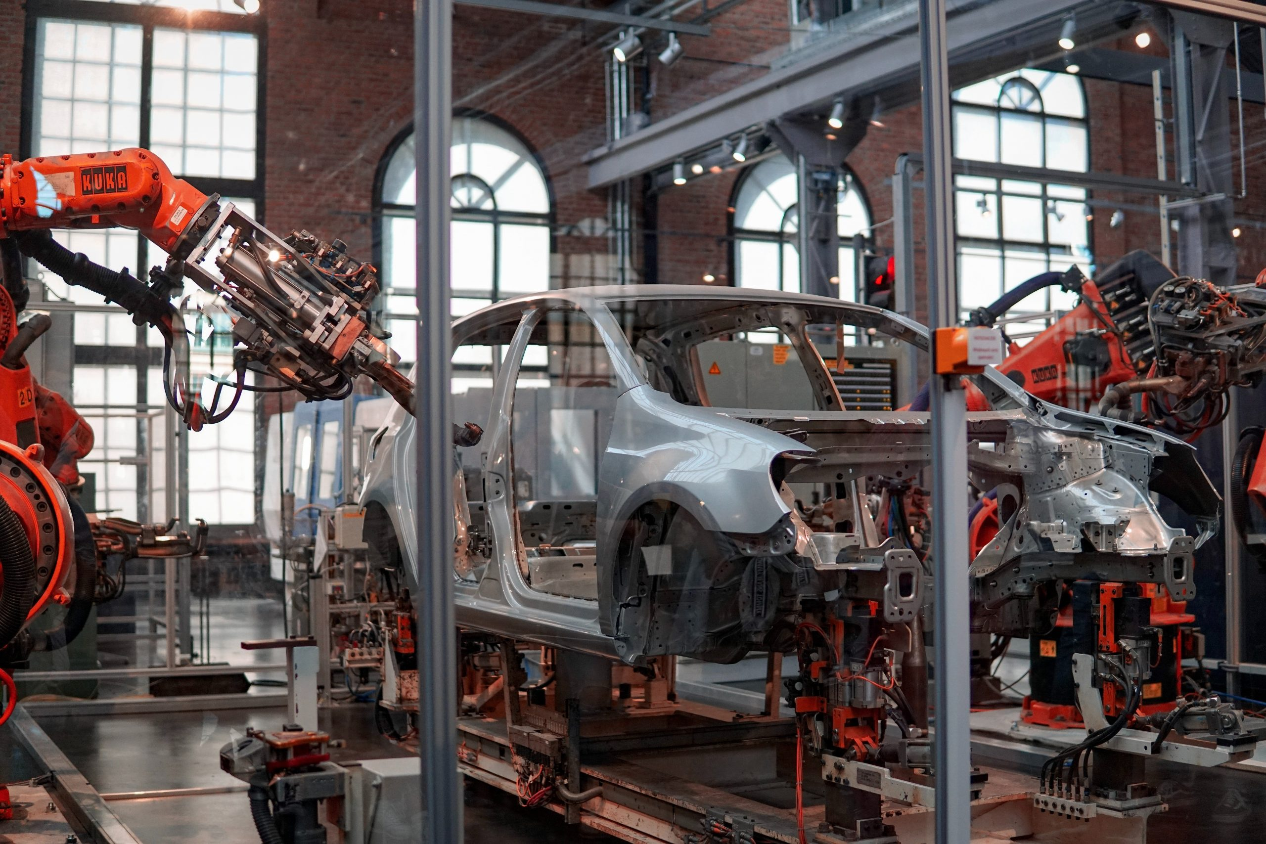 A decorative image of an automotive vehicle being worked on.